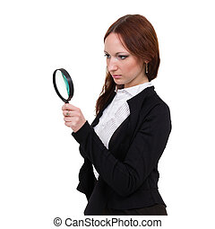 Surprised young woman with magnifying glass