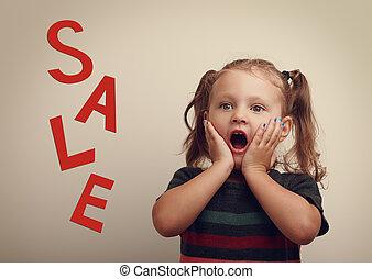Surprising cute kid girl looking on sale text advertising...