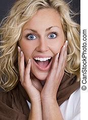 Surprisingly Happy - Studio shot beautiful young blond woman...