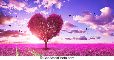 Surreal landscape with pink tree in the shape of heart on blooming meadow at sunset sky.