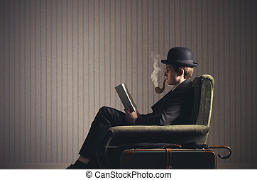 Surreal - Bizarre man sitting on armchair reading a book and...