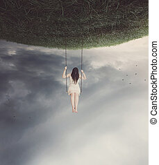Surreal swing with woman - Sad woman swinging on a surreal ...