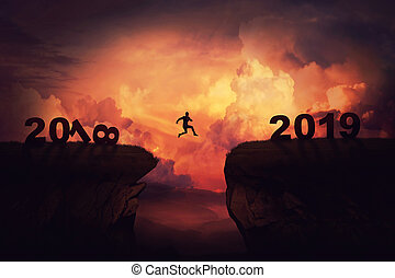 between 2018 and 2019 - Surreal view as a businessman jump...