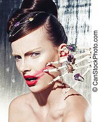 Surrealistic fashion portrait of a woman wearing jewellery