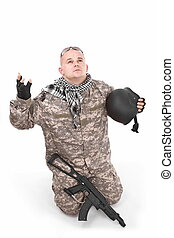 surrender - soldier with hands up, isolated in white