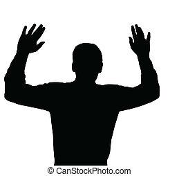 Surrendering - Man surrendering with both hands raised in...