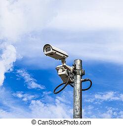 surveillance camera against blue sky