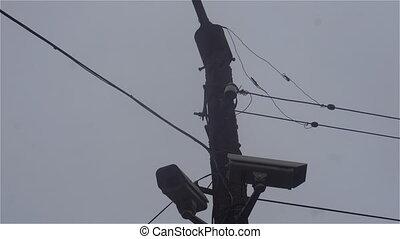 surveillance camera on a lamp post on blue sky...