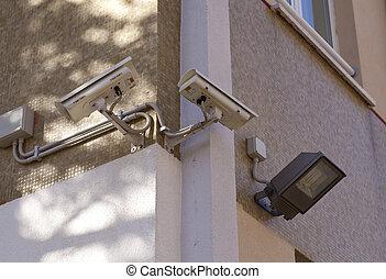 Surveillance camera on the wall