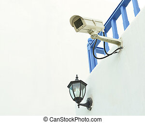 Surveillance camera on the wall
