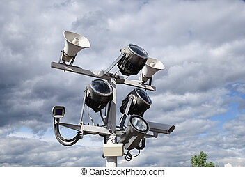Surveillance cameras, floodlights and loudspeakers on outdoor pole