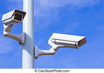 Surveillance cameras - Two surveillance cameras on a pole,...