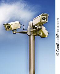 Surveillance cameras - Three surveillance cams on a metal...