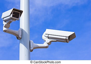 Surveillance cameras - Two surveillance cameras on a pole,...