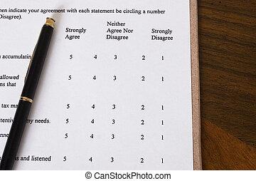 Business survey with pen