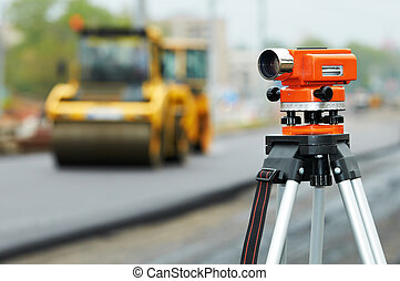 survey equipment at asphalting works - Construction surveyor...