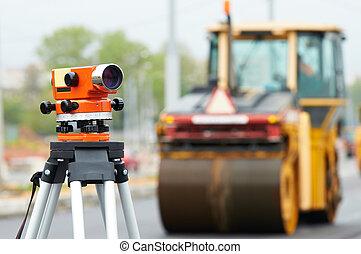 survey equipment at asphalting works - Construction surveyor...
