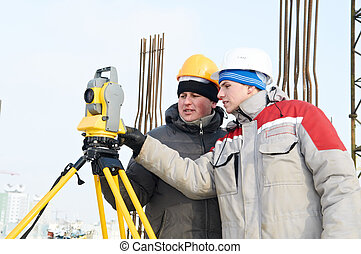 Surveying works at construction site