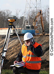 Surveyor at construction site