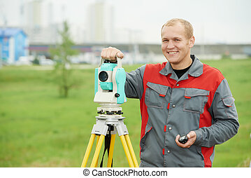surveyor at construction site - Surveying industry. smiling...