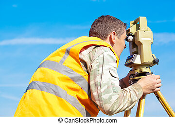 Surveyor engineer with theodolite