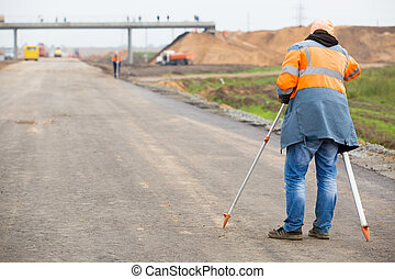 Surveyor engineer with theodolite - Surveyor engineer making...