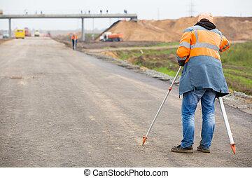 Surveyor engineer with theodolite - Surveyor engineer making...