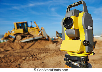Surveyor equipment at construction site - Surveyor equipment...