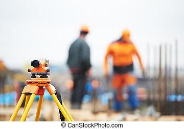 surveyor equipment level at construction site - Surveying...