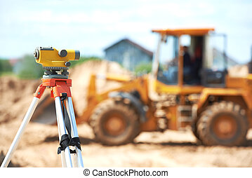 surveyor equipment level at construction site