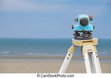 Surveyor equipment tacheometer on nature background