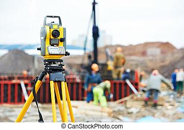 surveyor equipment theodolite at construction site -...