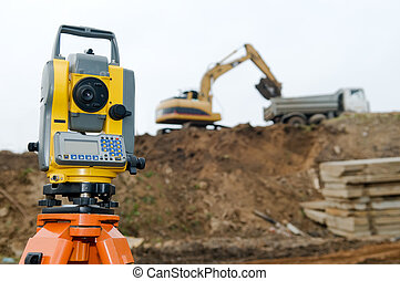 Surveyor equipment theodolite on tripod at building area in ...