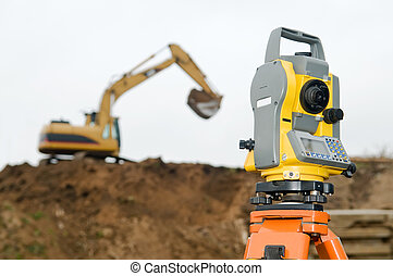 Surveyor equipment theodolite on tripod at building area in...