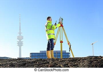 Surveyor in Munich on hill