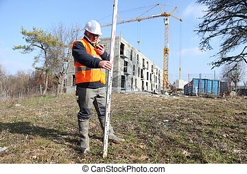 surveyor on a construction site