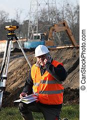 Surveyor on the phone