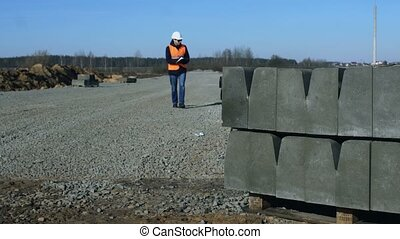 Surveyor or chief looks and writes information about curbs...