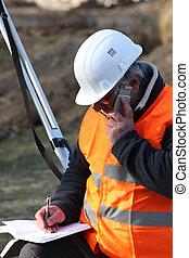 surveyor talking on the phone