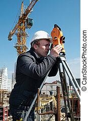 Surveyor with transit level equipment - worker surveyor ...