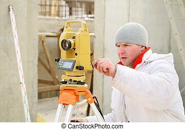 surveyor worker at construction site