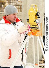 surveyor worker at construction site