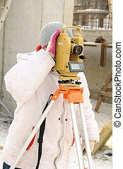 surveyor worker at construction site - Land surveyor and...