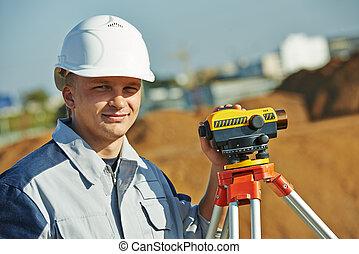 surveyor worker with level - Surveyor builder worker with...