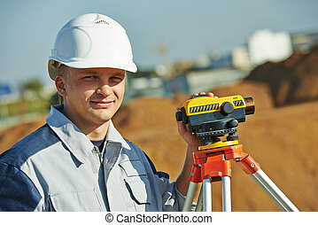 surveyor worker with level - Surveyor builder worker with ...
