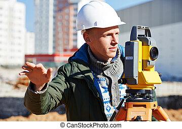 surveyor worker with theodolite - Surveyor builder worker...