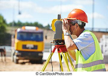 surveyor worker with theodolite - Portrait of builder worker...