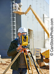 surveyor worker with theodolite - Surveyor builder worker...