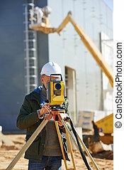 surveyor worker with theodolite - Surveyor builder worker ...