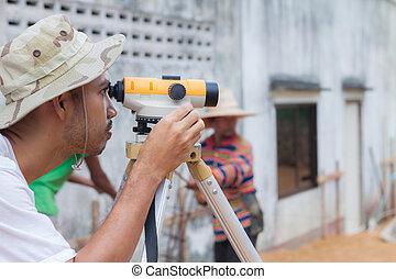 Surveyor worker working with theodolite